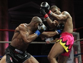 Francois Ambang (left) lands a punch to the midsection of Marcus Fischer (right) during their Semi-Final bout in Road To Glory at the Capitale Ballroom in New York, NY on Friday, March 22, 2013.  © Edward Diller